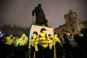 Police around a statue of Churchill in front of houses of parliament