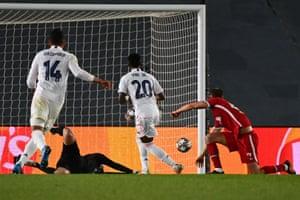 Real Madrid's Brazilian forward Vinicius Junior (C) scores his team's third goal.