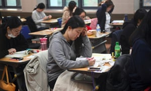 Students sit exams at a high school in Seoul. Government guidelines say that if men spend a lot of money on dates it is 'natural' for them to want to be compensated.