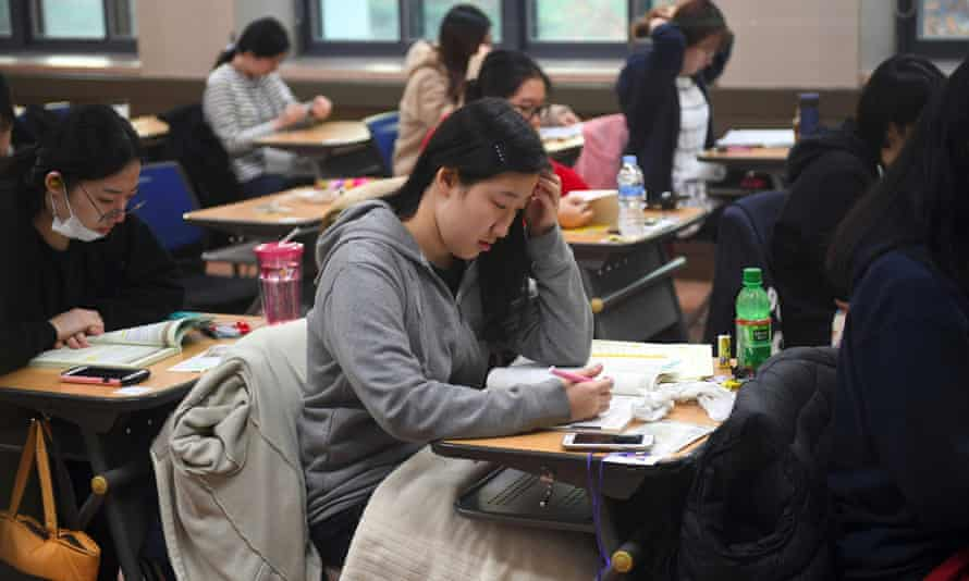 Students sit the annual college scholastic ability test at a high school in Seoul, South Korea, on Thursday.