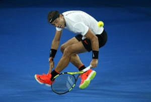 Rafael Nadal makes a backhand return.