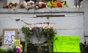 Flowers and signs are displayed at a makeshift memorial outside of the Gold Spa in Atlanta.