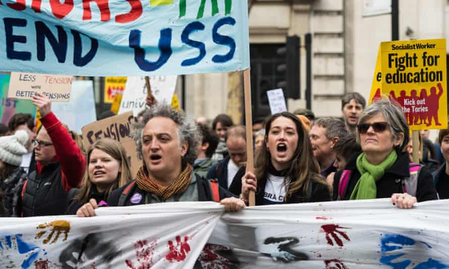 Staff and students in a protest march in support of the lecturers' strike over pensions cuts.
