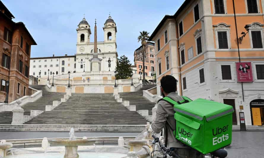 An Uber Eats delivery rider in central Rome, Italy, in March.