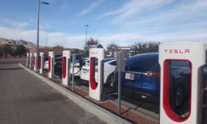 Teslas at a charging station