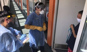 Medical assistants conduct a check on a quarantined homeless woman after coronavirus spread through a detox center in Gallup, New Mexico.
