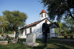 Ramiro R. Ramirez poses for a photo at the Jackson Ranch Chapel and Cemetery that could end up on the south side of Trump's border wall on Monday, Dec. 9, 2019 near Pharr, Tex.