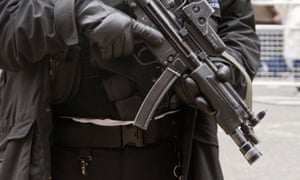 Armed police officer with submachine gun