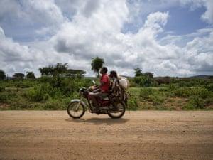 Beka Bergi Gaito (38) rides on a motorcycle with a goat