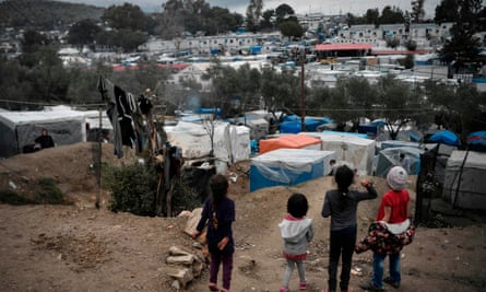 Children at the overcrowded Moria migrant camp on the Greek Aegean island of Lesbos on 5 March 2020..