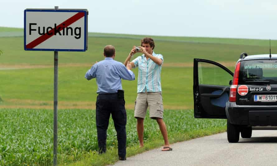 Tourists taking pictures of the road sign of the village of Fucking. Some visitor have reportedly even stolen the signposts.