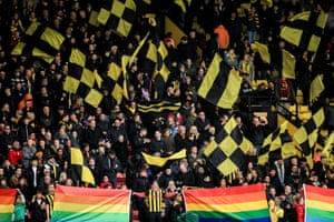 Fans of Watford hold rainbow flags in support of the Rainbow Laces Campaign prior to the Premier League match between Watford and Crystal Palace at Vicarage Road.