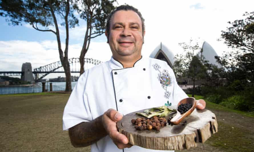 Indigenous chef Clayton Donovan poses for a photograph with native bush tomatoes, lemon myrtle leaves and pepper berries in Sydney.