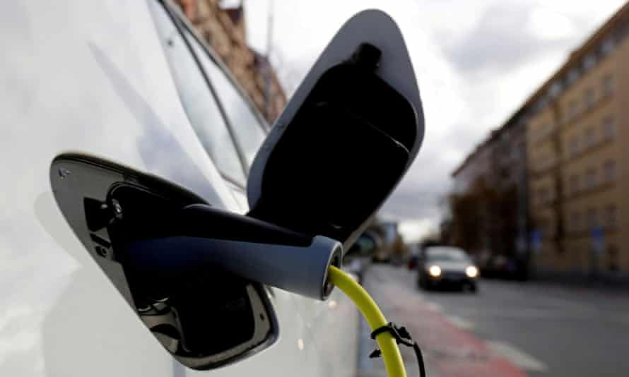 An electric car is charged by a mobile charging station on a street in Prague, Czech Republic.