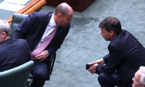 Treasurer Josh Frydenberg (left) talks to the energy minister Angus Taylor in the House of Representatives on Tuesday.