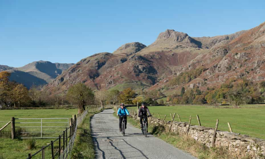 A couple cycling in the Langdale Valley