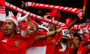 Indonesia's fans cheer before the start of a match against Malaysia in 2010