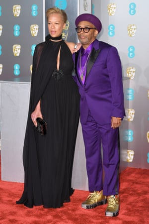 "Tonya Lewis Lee and Spike Lee sparking a million #couplegoalz posts. BlackKklansman director Lee's gold trainers had ""Speak On It"" written along the sides."