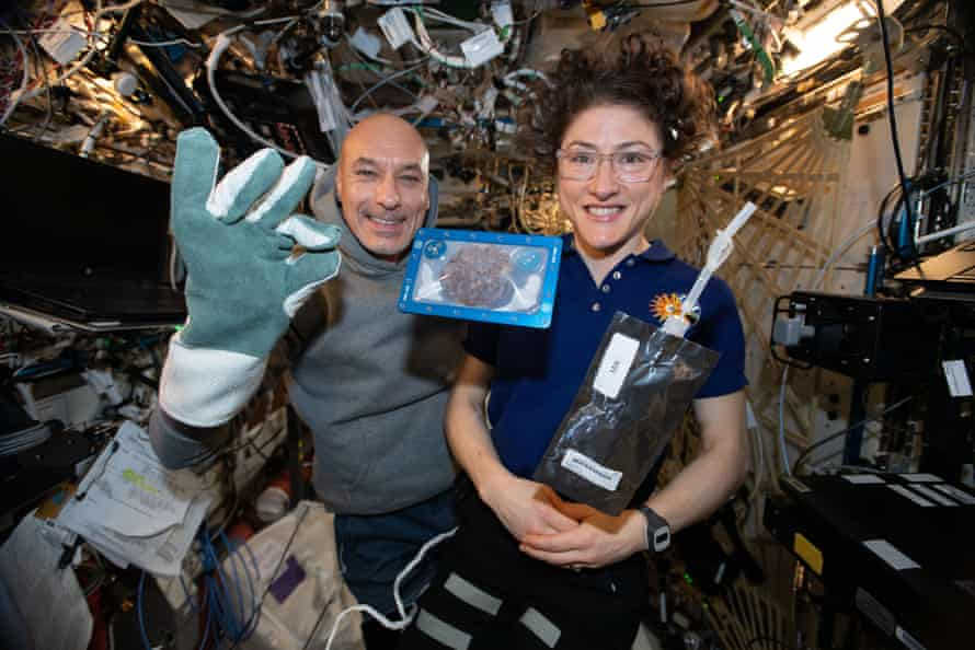 ISS commander Luca Parmitano and astronaut Christina Koch with milk and cookies on board the International Space Station (ISS).