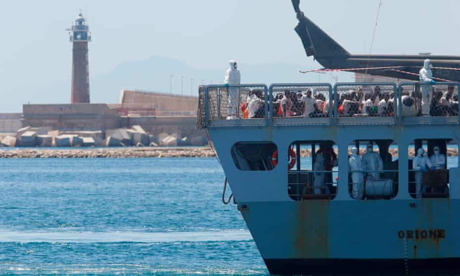 The Italian navy ship Orione enters the Spanish port of Valencia on 17 June carrying 630 migrants from north Africa.