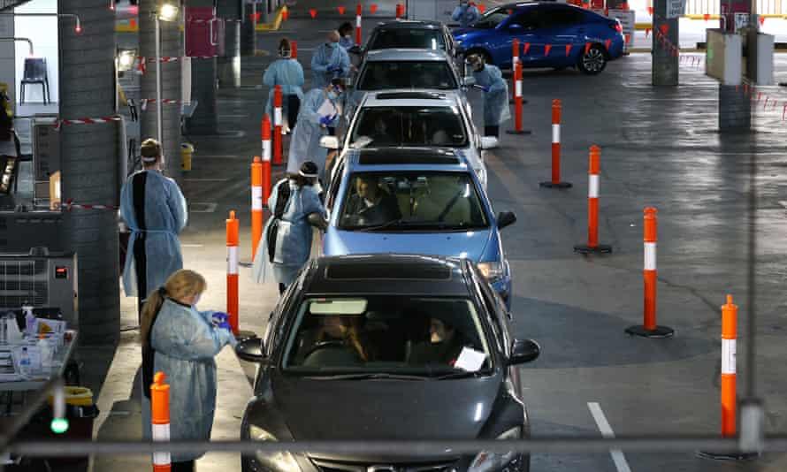 People queue for a coronavirus test in Melbourne, Australia.
