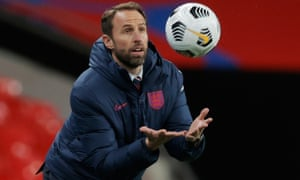 Gareth Southgate catches the ball on the sidelines during England's Nations League match with Belgium at Wembley in October 2020