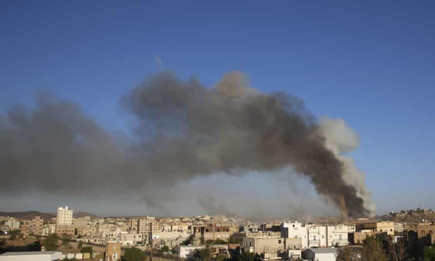 Smoke rises from a weapons depot in Sana'a hit by a Saudi airstrike