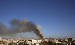 Smoke rises after an airstrike by the Saudi-led coalition at a weapons depot in Sana'a.