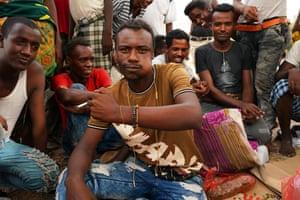 Ibrahim Jundi, 25, wearing a beaded bracelet bearing the word 'lucky'
