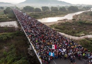 Aerial view of Honduran migrants heading in a caravan to the US, as the leave Arriaga on their way to San Pedro Tapanatepec, in southern Mexico