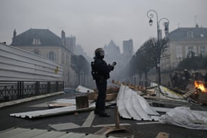 A riot police officer holds a position as other advance after clearing a barricade during a demonstration in Bourges.