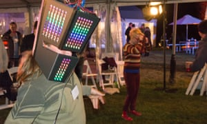 Woman with LED lights shaped into Ned Kelly mask