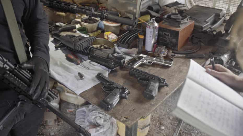Weapons belonging to the Sinaloa Cartel are repaired in a workshop located in the countryside near Culiacán (Sinaloa, Mexico). Heckler & Koch (Germany), Beretta (Italy) and Llama (Spain) pistols sit on the work table.