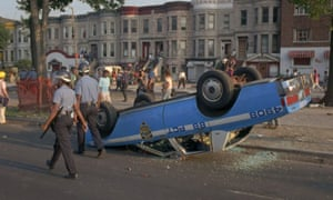 A police car overturned by rioters during the Crown Heights unrest of August 1991.