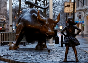 A statue of a girl facing the Wall St Bull is seen, as part of a campaign by U.S. fund manager State Street to push companies to put women on their boards, in the financial district in New York, U.S., March 7, 2017. REUTERS/Brendan McDermid