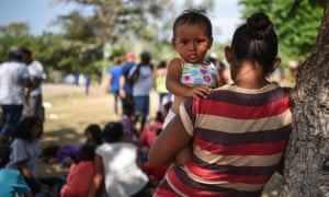 Central Americans – taking part in a migrant caravan – rest at a sports center field in Matías Romero, Oaxaca, Mexico, on Tuesday.