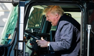 Trump in the driver's seat of an 18-wheeler while meeting with truck drivers and trucking CEOs in March