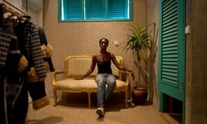 Loza sits in the showroom of her clothing line in Abidjan.