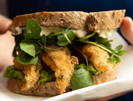 Fish finger sandwich with minty pea puree and tartare sauce.