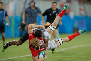 Fijian Apisai Domolailai tackles Sam Cross of Great Britain in the rugby sevens final at Deodoro