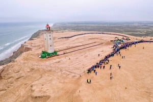 Lonstrup, Denmark: The lighthouse in Rubjerg Knude is moved back from the sea. The 120-year-old structure was put on wheels and rails to move it 80 metres away from the North Sea, which has eroded the coast.