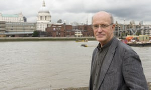 Iain Sinclair on the south bank of the river Thames, London.