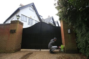 A local well-wisher leaves flowers outside the home of Sir Terry Wogan in Taplow, Buckinghamshire
