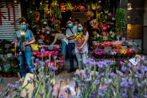 People in masks shop for plants and flowers, Hong Kong