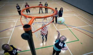 Netball players on court in Liverpool.