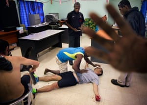 A photograph capturing the assault of two refugees at the Manus Island detention centre. August 10, 2016. Photo by Matthew Abbott for The Guardian.