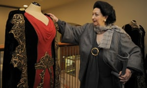 Montserrat Caballé looks at a dress on 3 January 2012 which was part of an exhibition commemorating the 50th anniversary of her debut at the Gran Teatre del Liceu in Barcelona