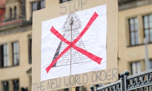 A protester's sign saying 'Stop The New World Order' near the venue of the 2016 Bilderberg conference in Dresden, Germany.