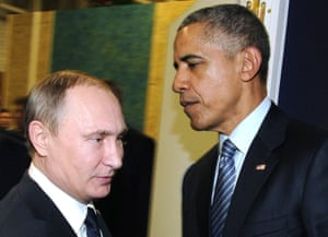 The Russian president, Vladimir Putin, left, and the US president, Barack Obama, on the sidelines of the Paris climate talks on Monday.