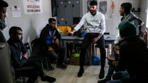 Ali Shama Eddin, from the charity Movement on the Ground, mediates a dispute in the camp.